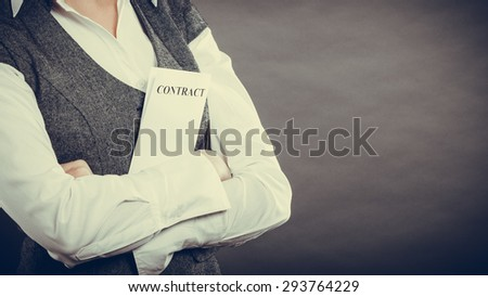 Business documents legal concept - closeup businesswoman holding contract in hand