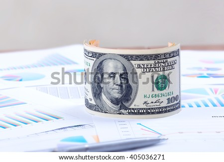 Business documents, marketing plan, advertising budget, the exchange and the bank reports. U.S. dollar. - stock photo