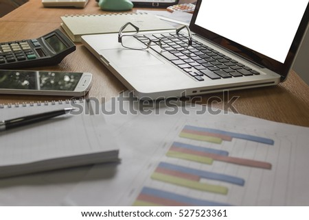 Business documents on desk.