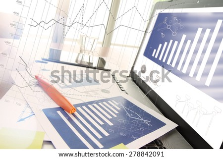 business documents on office table with smart phone and digital tablet and modern pen with laptop computer in workspace concept - stock photo