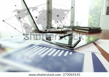 business documents on office table with smart phone and digital tablet as work space business with social network diagram concept  - stock photo
