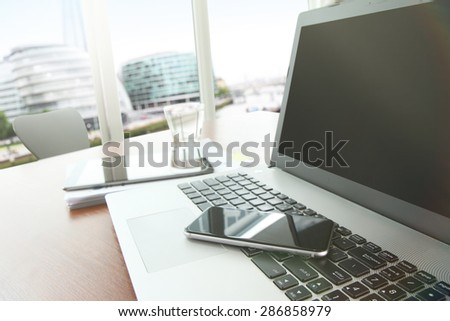 business documents on office table with smart phone and digital tablet as workspace business with blank screen computer laptop