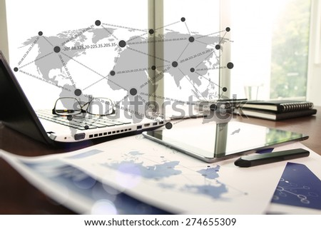 business documents on office table with smart phone and stylus pen and laptop computer with social network diagram concept  - stock photo