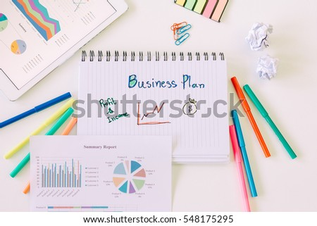 Business documents on office table with touch pad and graph financial and business stuff.