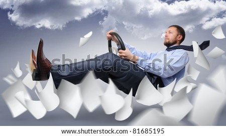 Business driver fly through the expanding white paper on the background of clouds, concept idea - stock photo