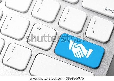 Business & e-commerce icon on computer keyboard button - stock photo