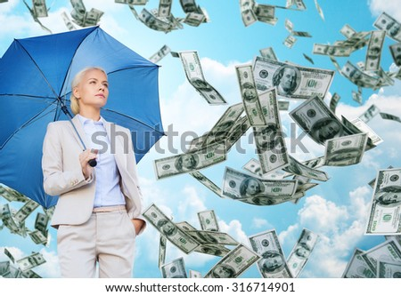 business, economy, finances and people and concept - young businesswoman with umbrella over blue sky and clouds background - stock photo