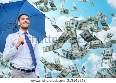 business, economy, finances and people and concept - young smiling businessman with umbrella over blue sky and clouds background - stock photo