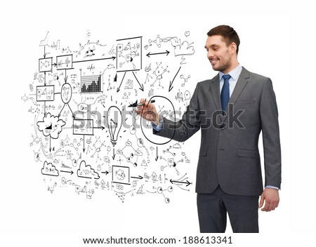business, education and office concept - attractive buisnessman or teacher with marker writing or drawing something