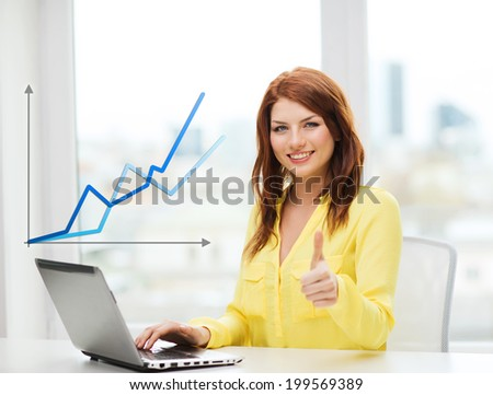 business, education and technology concept - smiling student with book laptop computer at school showing thumbs up - stock photo