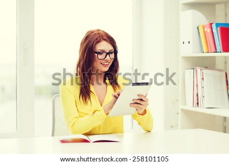 business, education and technology concept - smiling student with tablet pc computer and notebook in college
