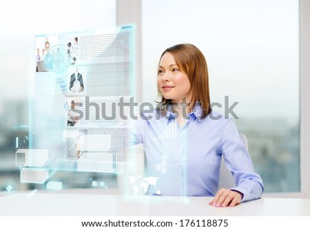 business, education and technology concept - smiling woman pointing to news on virtual screen - stock photo