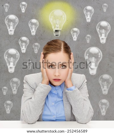 business, education, emotional pressure and people concept - stressed businesswoman or student covering her ears with hands over concrete background with light bulbs - stock photo