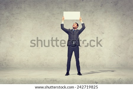 business, education, office and advertising concept - smiling businessman with small white blank board - stock photo