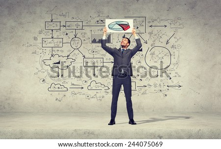 business, education, office and advertising concept - smiling businessman with small white board with pie diagram - stock photo