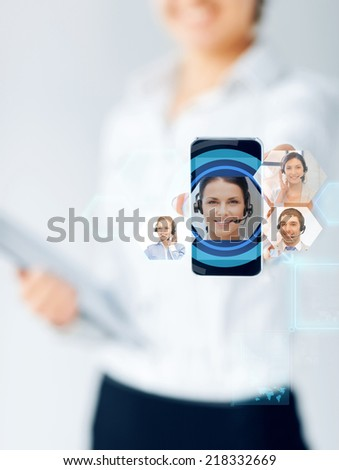business, education, people and technology concept - close up of businesswoman showing smartphone screen with video chat icons - stock photo