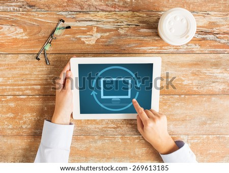 business, education, people and technology concept - close up of female hands pointing finger and restarting tablet pc computer at table - stock photo
