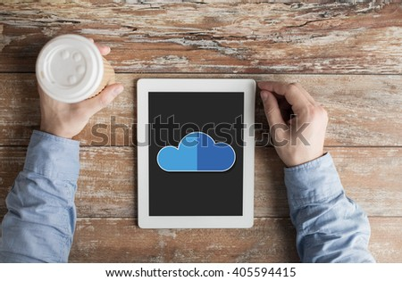 business, education, people and technology concept - close up of male hands with cloud computing icon on tablet pc computer screen and coffee cup at table - stock photo