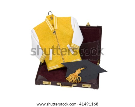 Business education shown by letterman jacket with a graduation mortar in a leather briefcase - path included - stock photo