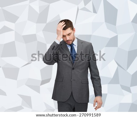 business, education, stress and fail concept - handsome businessman having headache over gray graphic low poly background