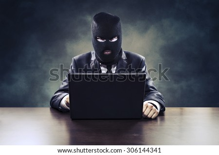 Business espionage hacker stealing corporate information or government surveillance privacy violation - stock photo