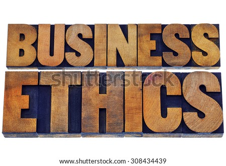 business ethics - isolated text in letterpress wood type printing blocks stained by color inks