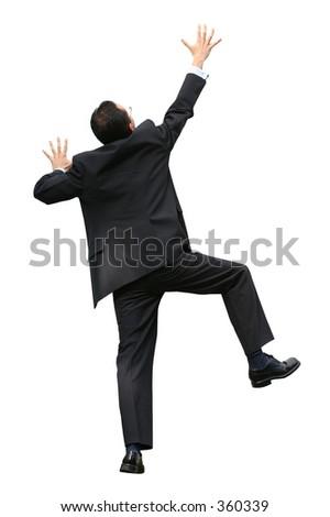 business executive climbing a wall - determination - stock photo