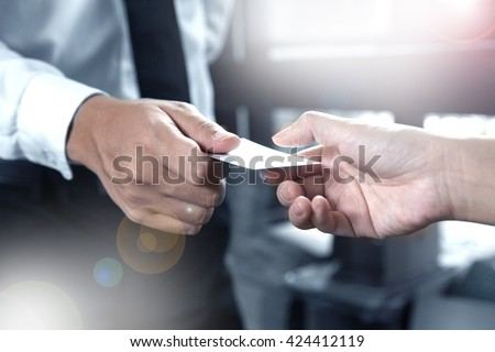 business executive exchanging business card - stock photo