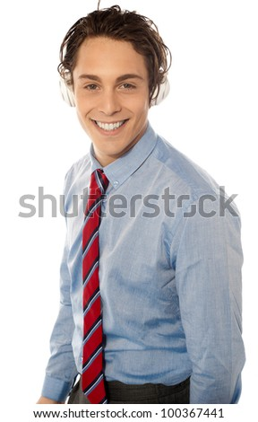 Business executive listening to music on headphones - stock photo