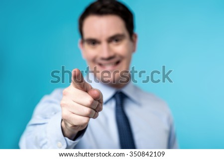 Business executive pointing you out - stock photo