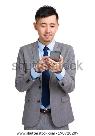 Business executive texting on cell phone - stock photo