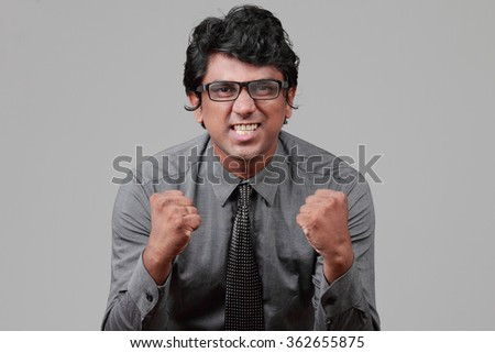 Business executive with a motivational gesture - stock photo