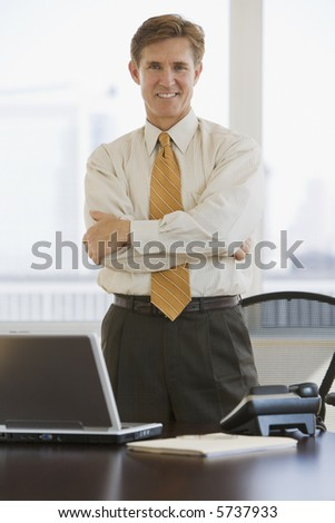Business executive with crossed arms looking at camera