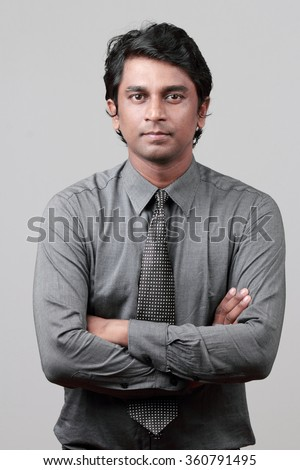Business executive with folded hands