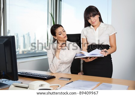 Business executive with personal assistant - stock photo