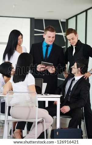 Business executives at a meeting discussing a work