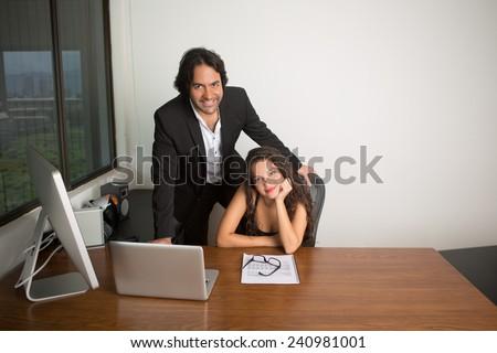 Business executives at the office looking at camera - stock photo