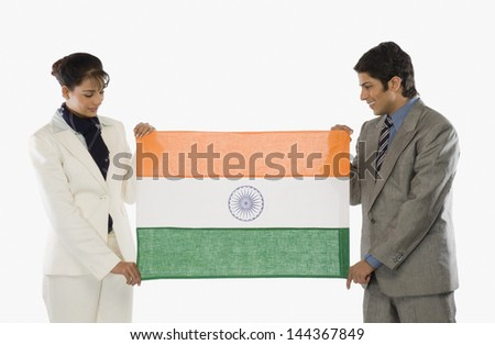 Business executives holding an Indian flag - stock photo