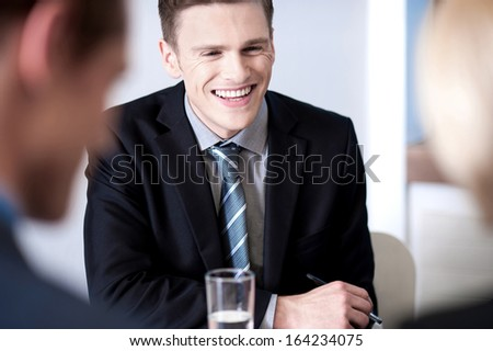 Business executives in a conference meeting - stock photo