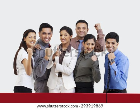 Business executives rejoicing during cricket match - stock photo