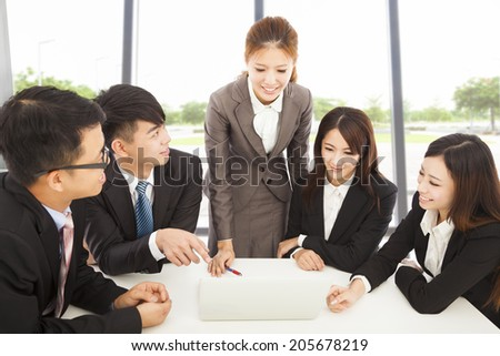 business female manager briefing all colleagues in office - stock photo