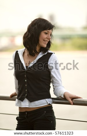 Business female outdoor Portraits in front of a modern office building