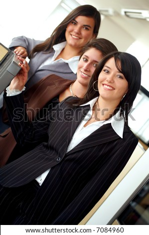 business female team portrait in an office environment - all looking friendly and smiling