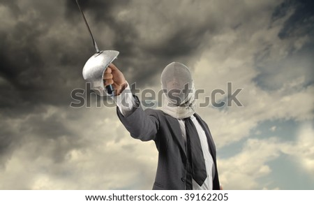 business fight concept: businessman in fencing suit - stock photo