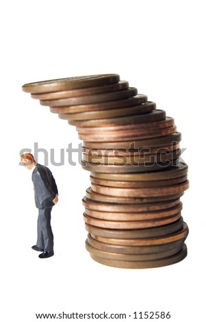 business figure and stack of coins - stock photo