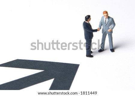 Business figures and arrow - stock photo