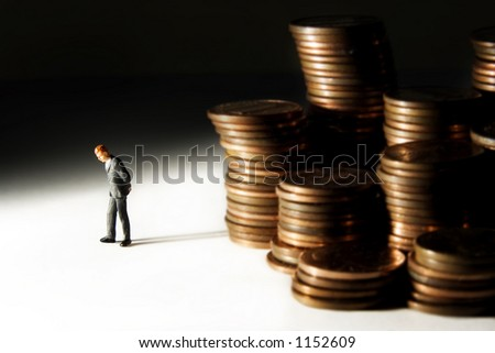 Business figures and stacks of coins - stock photo