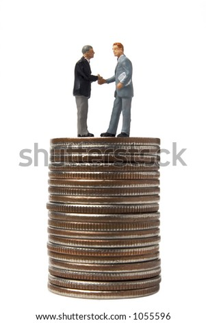 Business figures with coins - stock photo