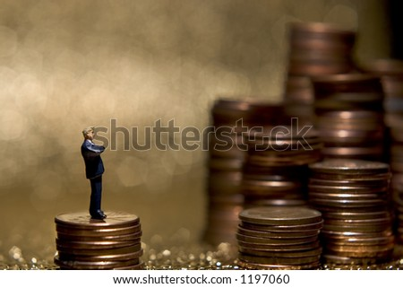 Business figures with money. - stock photo