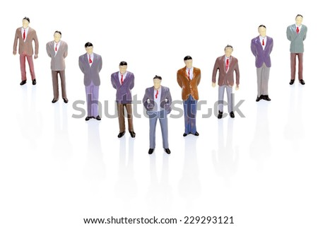 Business Figurine in V-Formation Hierarchy - stock photo